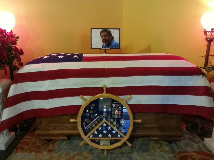Len's casket